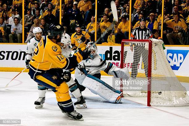 Mike Fisher of the Nashville Predators scores a goal against goalie Martin Jones of the San Jose Sharks during the first period of Game Four of the...