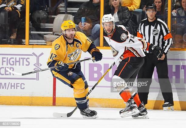 Mike Fisher of the Nashville Predators skates against Joseph Cramarossa of the Anaheim Ducks during an NHL game at Bridgestone Arena on November 12...