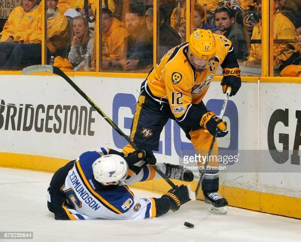 Mike Fisher of the Nashville Predators skates past Carl Gunnarsson of the St Louis Blues during the third period in Game Three of the Western...