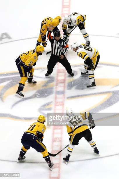 Mike Fisher of the Nashville Predators takes the opening faceoff against Sidney Crosby of the Pittsburgh Penguins in Game Four of the 2017 NHL...