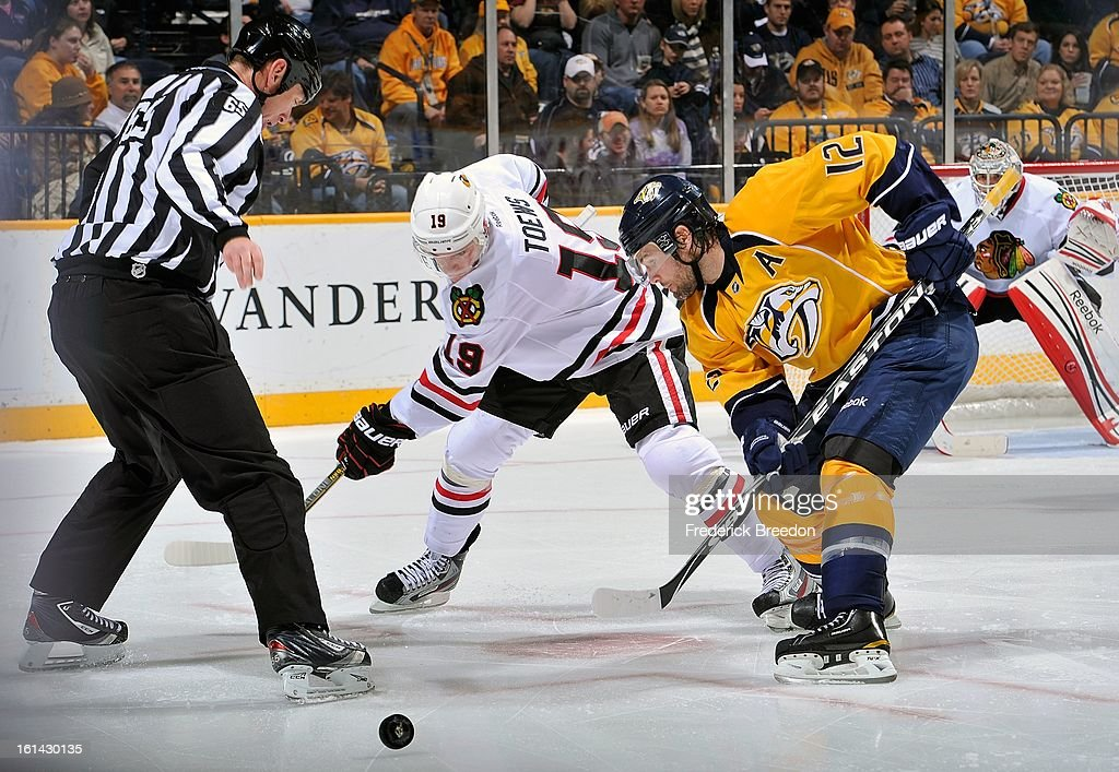 Mike Fisher #12 of the Nashville Predators wins a faceoff against Jonathan Toews #19 of the Chicago Blackhawks at the Bridgestone Arena on February 10, 2013 in Nashville, Tennessee.