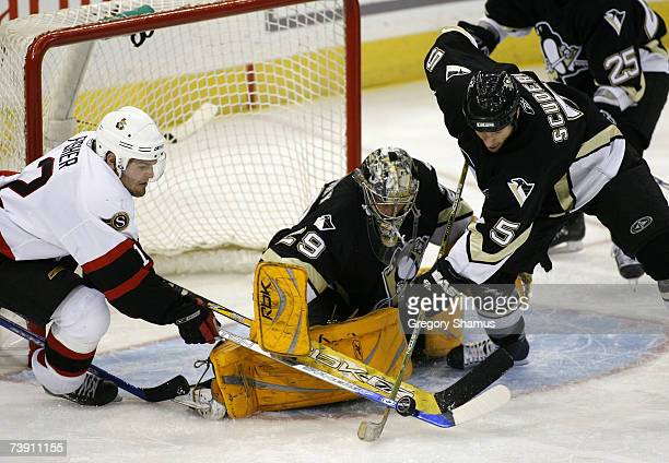 Mike Fisher of the Ottawa Senators can't get the puck past MarcAndre Fleury and Rob Scuderi of the Pittsburgh Penguins during game 4 of the 2007...