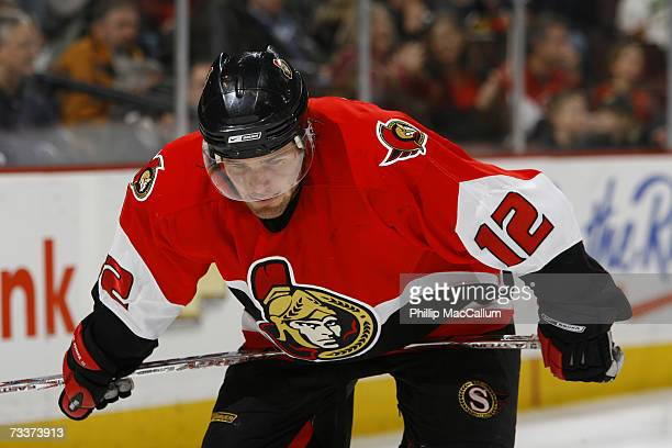 Mike Fisher of the Ottawa Senators rest his stick on his waist waiting for a faceoff during a game against the Atlanta Thrashers on February 17 2007...