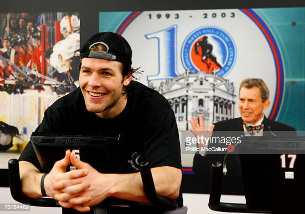 Mike Fisher of the Ottawa Senators rides the stationary bike in front of a photo of former assistant coach Roger Neilson after a victory against the...