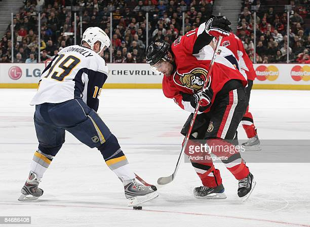 Mike Fisher of the Ottawa Senators stickhandles the puck aroound Tim Connolly of the Buffalo Sabres at Scotiabank Place on February 7 2009 in Ottawa...