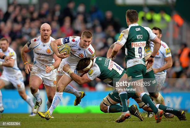 Mike Fitzgerald of Leicester Tigers is tackles Gareth Steenson of Exeter Chiefs during the Aviva Premiership match between Leicester Tigers and...