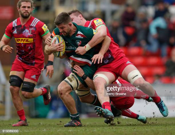 Mike Fitzgerald of Leicester Tigers tackled by Stan South and Jonno Kitto of Harlequins during the Aviva Premiership match between Leicester Tigers...