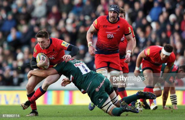 Mike Fitzgerald of Leicester Tigers tackles Josh Adams of Worcester Warriors during the Aviva Premiership match between Leicester Tigers and...