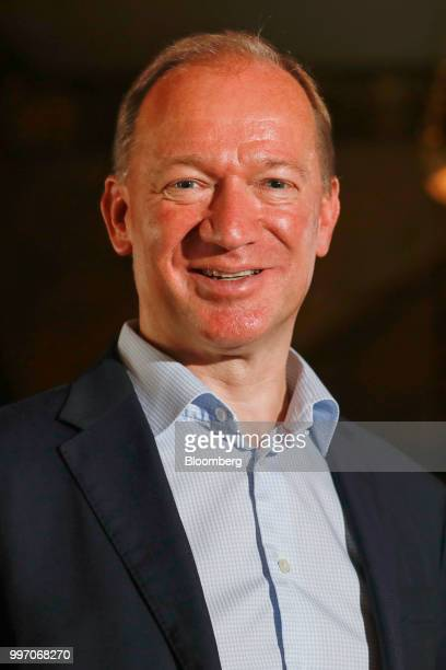 Mike Flewitt chief executive officer of McLaren Automotive Ltd poses for a photograph following a news conference at the Goodwood Festival of Speed...