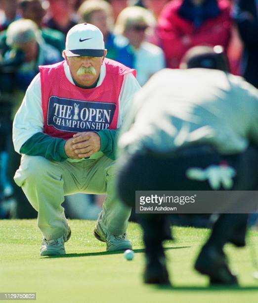 "Mike ""fluff"" Cowan helps Tiger Woods line up a putt during the 127th British Open Golf at Royal Birkdale GC in Southport 16th-19th July 1998."