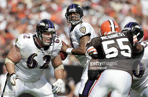 Mike Flynn of Baltimore Ravens protects quarterback Steve McNair as Willie McGinest of the Cleveland Browns pressures in the first quarter at...