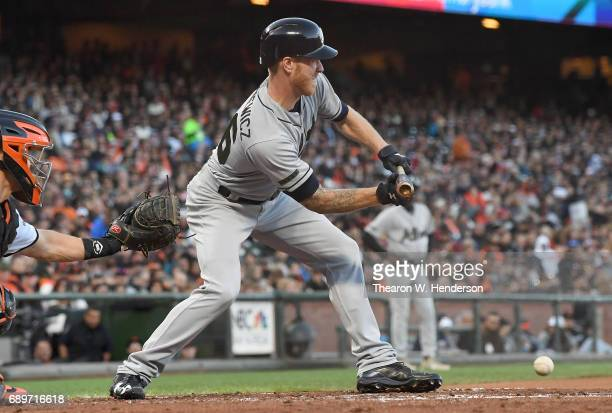 Mike Foltynewicz of the Atlanta Braves attempts a sacrifice bunt against the San Francisco Giants in the top of the third inning at ATT Park on May...