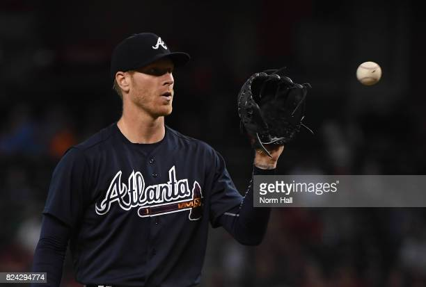Mike Foltynewicz of the Atlanta Braves catches a throw back from home plate against the Arizona Diamondbacks at Chase Field on July 25 2017 in...