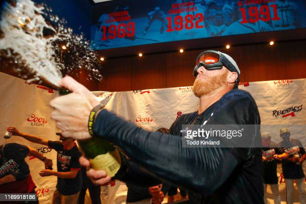 Mike Foltynewicz of the Atlanta Braves celebrates in the clubhouse with champagne at the conclusion of an MLB game against the San Francisco Giants...