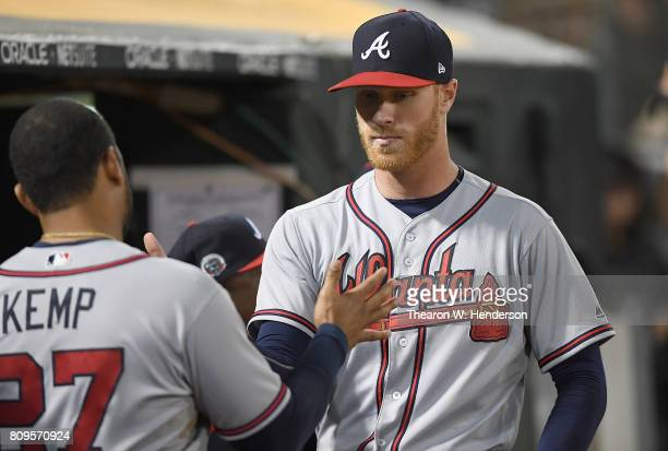 Mike Foltynewicz of the Atlanta Braves is congratulated by Matt Kempt and teammates for his pitching performance against the Oakland Athletics at...