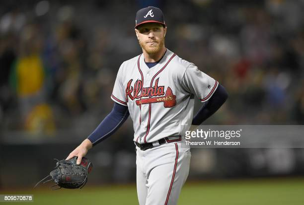 Mike Foltynewicz of the Atlanta Braves looks on as he leaves the game against the Oakland Athletics in the bottom of the ninth inning at Oakland...