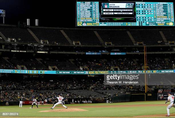 Mike Foltynewicz of the Atlanta Braves pitches against the Oakland Athletics in the bottom of the eighth inning at Oakland Alameda Coliseum on June...
