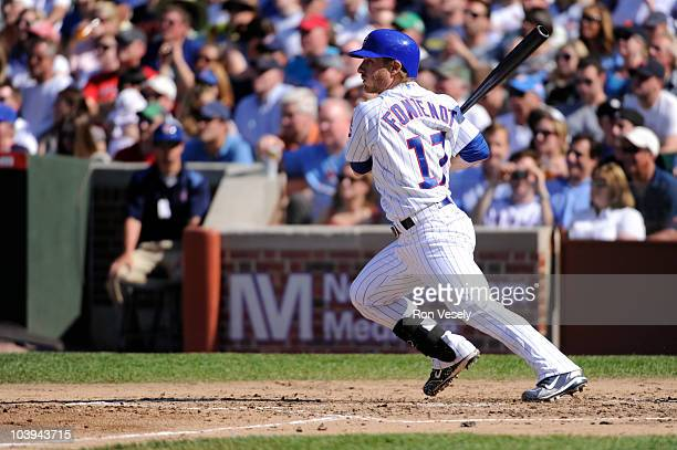 Mike Fontenot of the Chicago Cubs hits his second triple of the game against the St Louis Cardinals on May 29 2010 at Wrigley Field in Chicago...