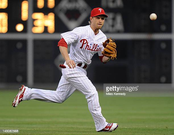 Mike Fontenot of the Philadelphia Phillies chases down a ground ball against the Washington Nationals in the second inning on May 21 2012 at Citizens...