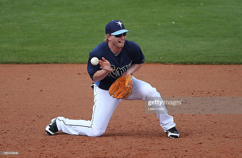 Mike Fontenot #7 of the Tampa Bay Rays attempts to make the play as the ball bounces off his chest into left field during the game against the Pittsburgh Pirates on February 23, 2013 in Port Charlotte, Florida.