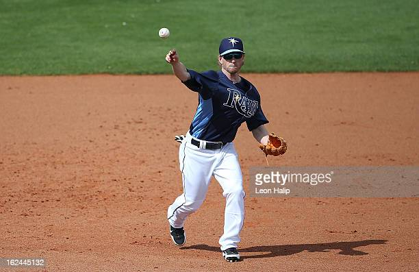 Mike Fontenot of the Tampa Bay Rays makes the throw to first base during the Spring Training game against the Pittsburgh Pirates on February 23 2013...