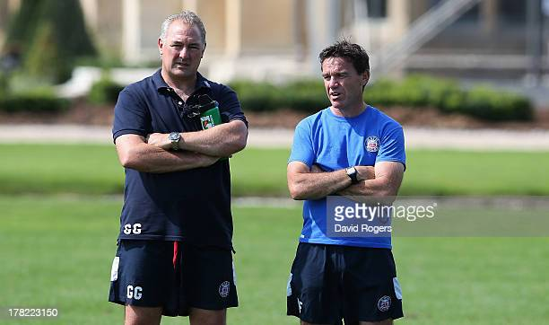 Mike Ford the head coach of Bath looks on with the Bath director of rugby Gary Gold in a training session held at Farleigh House on August 27 2013 in...