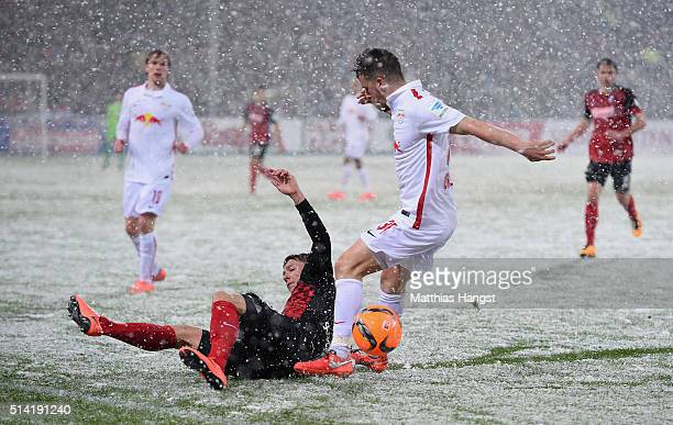 Mike Frantz of Freiburg and Diego Demme of RB Leipzig compete for the ball during the Second Bundesliga match between SC Freiburg and RB Leipzig at...
