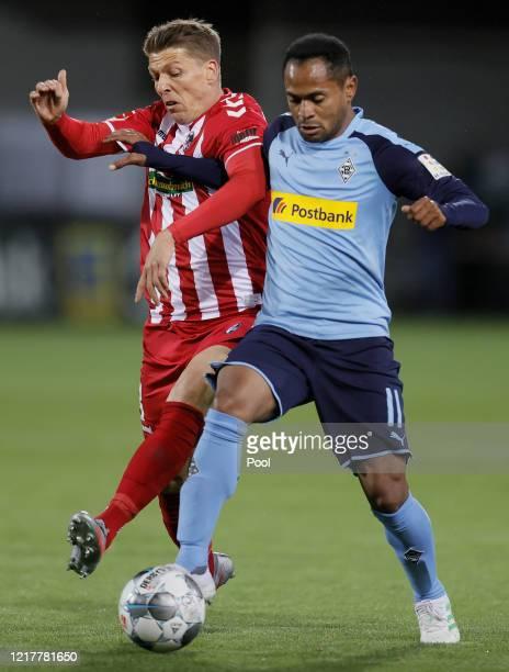 Mike Frantz of Freiburg and Raffael of Moenchengladbach in action during the Bundesliga match between SportClub Freiburg and Borussia...
