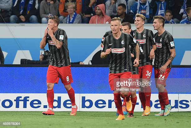 Mike Frantz of Freiburg celebrates with his teammates after scoring his team's second goal during the Bundesliga match between TSG 1899 Hoffenheim...
