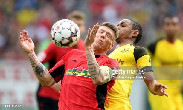 Mike Frantz of Freiburg challenges Abdou Lakhab Diallo of Dortmund during the Bundesliga match between SportClub Freiburg and Borussia Dortmund at...