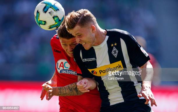 Mike Frantz of Freiburg goes up for a header with Nico Elvedi of Moenchengladbach during the Bundesliga match between Borussia Moenchengladbach and...
