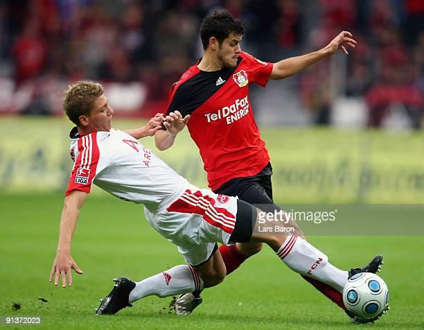 Mike Frantz of Nuernberg challenges Tranquillo Barnetta of Leverkusen during the Bundesliga match between Bayer Leverkusen and 1. FC Nuernberg at...