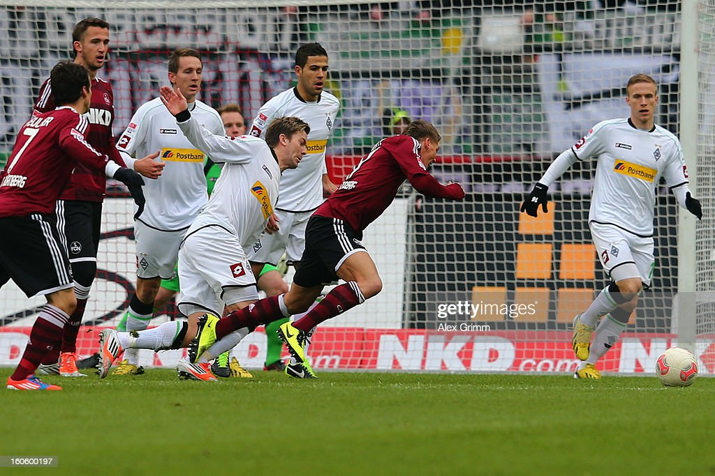 Mike Frantz of Nuernberg falls for a penalty during the Bundesliga match between 1. FC Nuernberg and VfL Borussia Moenchengladbach at Easy Credit Stadium on February 3, 2013 in Nuremberg, Germany.