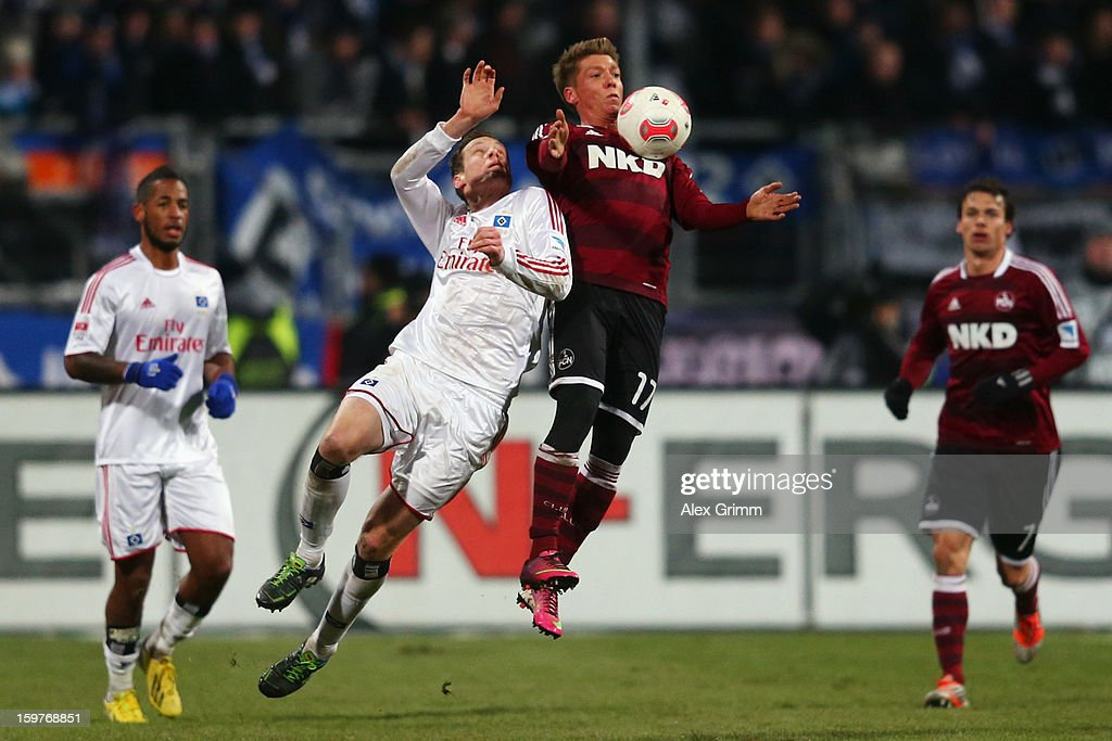 Mike Frantz (R) of Nuernberg is challenged by Marcell Jansen of Hamburg during the Bundesliga match between 1. FC Nuernberg and Hamburger SV at Easy Credit Stadium on January 20, 2013 in Nuremberg, Germany.