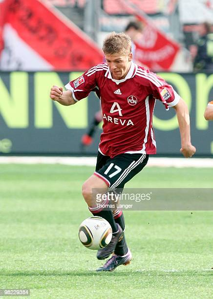 Mike Frantz of Nuernberg runs with the ball during the Bundesliga match between 1. FC Nuernberg and FSV Mainz 05 and at Easy Credit Stadium on April...