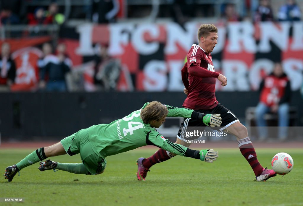 Mike Frantz of Nuernberg (R) scores his team's third goal past goalkeeper Timo Hildebrand of Schalke during the Bundesliga match between 1. FC Nuernberg and FC Schalke 04 at Grundig-Stadion on March 16, 2013 in Nuremberg, Germany.