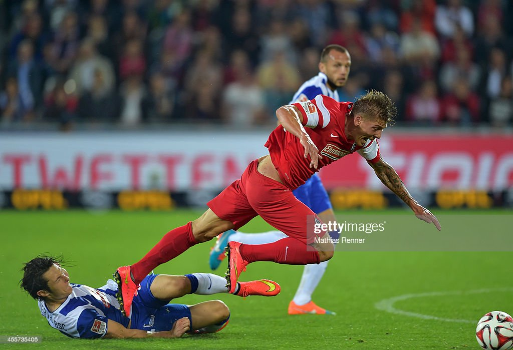 Mike Frantz of SC Freiburg and Nico Schulz of Hertha BSC during the Bundesliga match between SC Freiburg and Hertha BSC on september 19, 2014 in Freiburg, Germany.