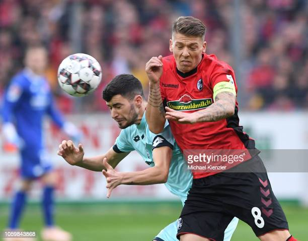 Mike Frantz of SC Freiburg challenges Aaron of FSV Mainz 05 during the Bundesliga match between Sport Club Freiburg and Mainz 05 at...