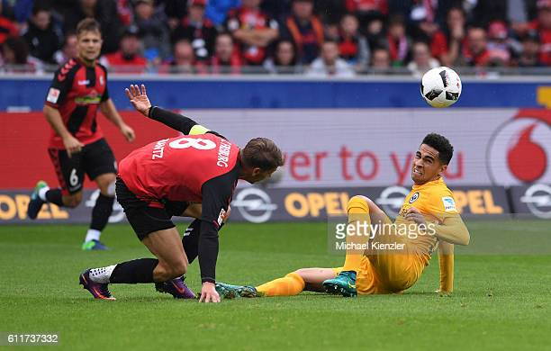 Mike Frantz of SC Freiburg challenges Omar Mascarell of Eintracht Frankfurt during the Bundesliga match between Sport Club Freiburg and Eintracht...