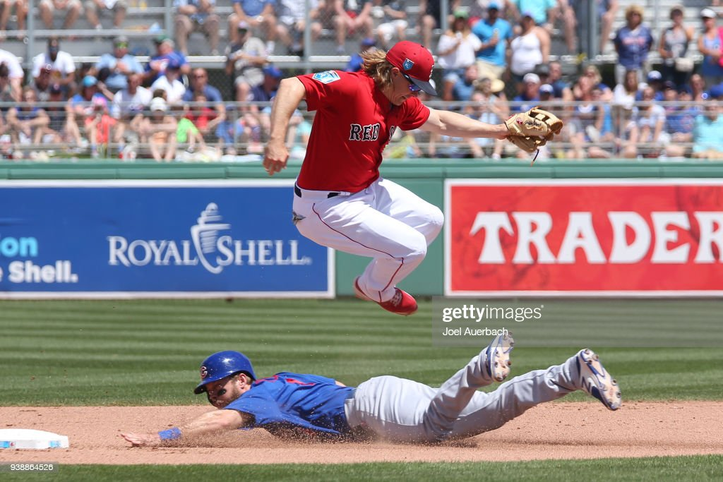 Mike Freeman #4 of the Chicago Cubs steals second base before Brock Holt #12 of the Boston Red Sox can tag him during the fourth inning of a spring training game at JetBlue Park on March 27, 2018 in Fort Myers, Florida. The Red Sox defeated the Cubs 4-2.