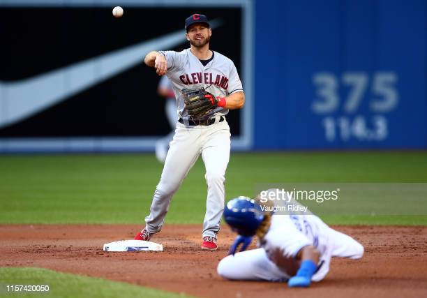 Mike Freeman of the Cleveland Indians throws to first base for a double play as Vladimir Guerrero Jr #27 of the Toronto Blue Jays is out at second...