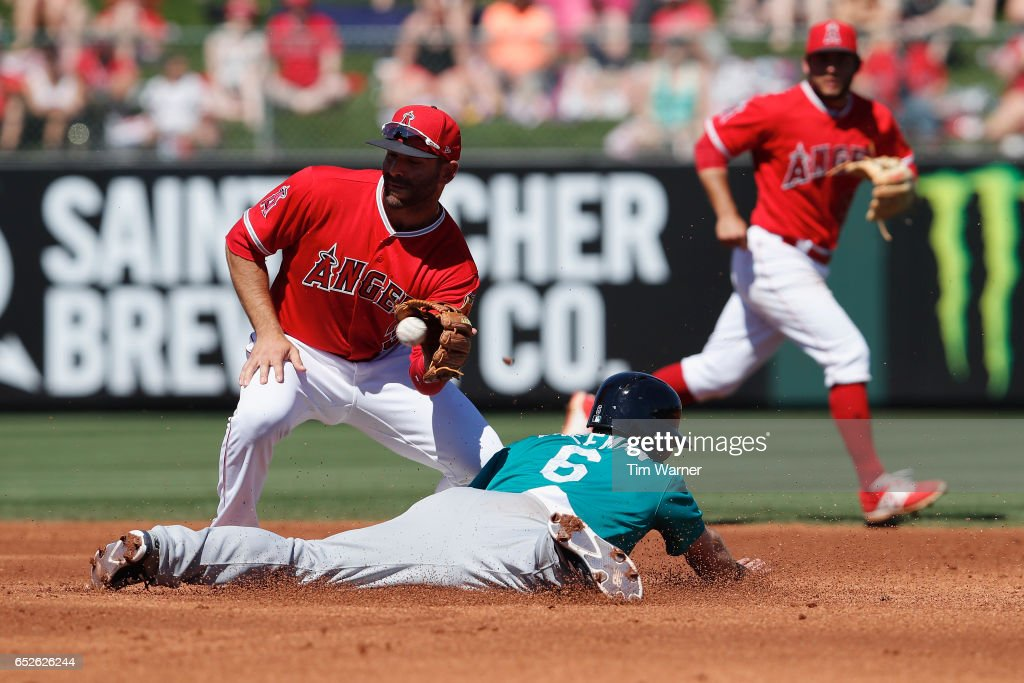 Mike Freeman #6 of the Seattle Mariners slides into second as Danny Espinosa #3 of the Los Angeles Angels of Anaheim fields the throw in the second inning during a spring training game at Tempe Diablo Stadium on March 12, 2017 in Tempe, Arizona.