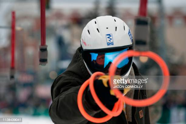 Mike Fries of Hopkins Minnesota practices spearing rings with his baton before racing in the 71st annual Leadville Ski Joring weekend competition on...