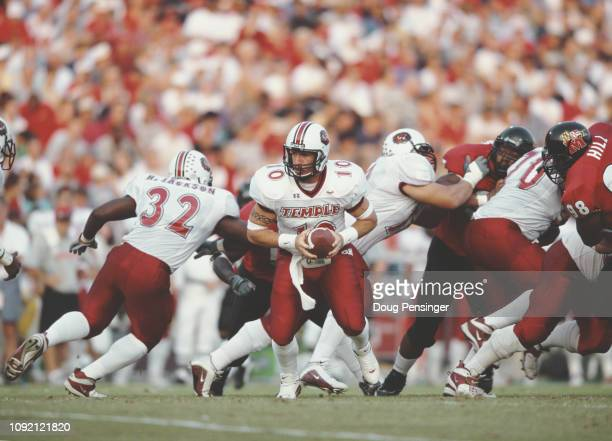 Mike Frost Quarterback for the Temple University Owls hands the ball off to Wide Receiver Harold Jackson during the NCAA Atlantic Coast Conference...