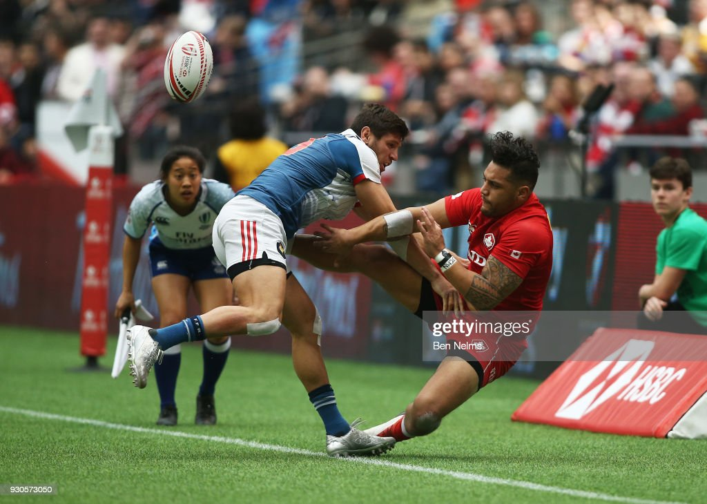 Mike Fuailefau of Canada is tackled by Jeremy Aicardi of France during the Canada Sevens, the Sixth round of the HSBC Sevens World Series at the BC Place stadium Centre on March 11, 2018 in Vancouver, British Columbia, Canada.