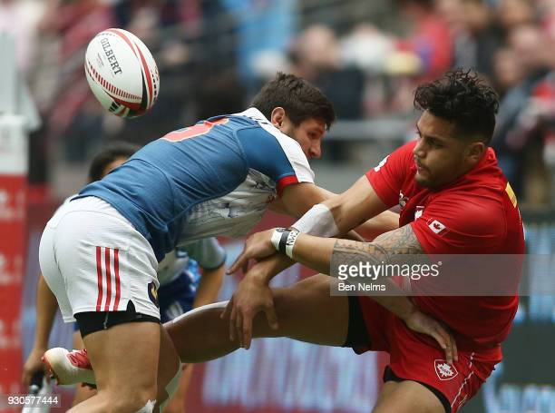 Mike Fuailefau of Canada is tackled by Jeremy Aicardi of France during the Canada Sevens the Sixth round of the HSBC Sevens World Series at the BC...