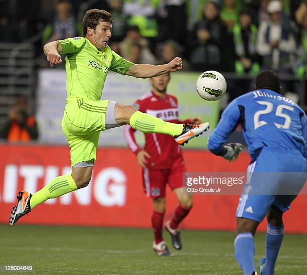 Mike Fucito of the Seattle Sounders FC shoots against goalkeeper Sean Johnson of the Chicago Fire during the 2011 Lamar Hunt US Open Cup Final at...