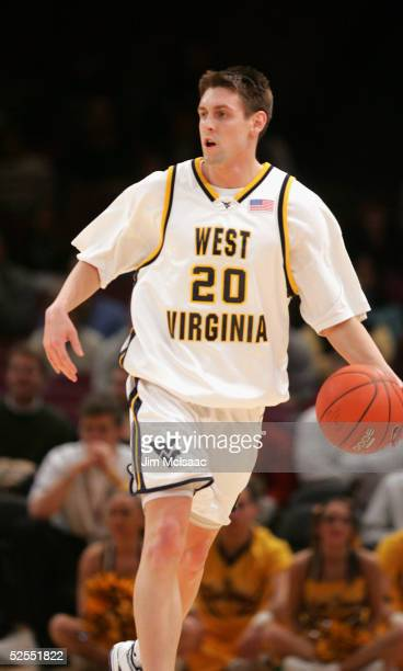Mike Gansey of the West Virginia University Mountaineers drives against the Providence College Friars during the Big East Men's Basketball...