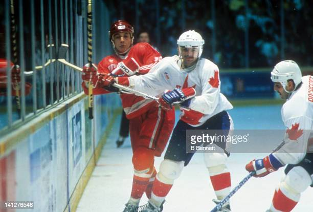 Mike Gartner of Team Canada check an unidentified player of Team USSR during the 1987 Canada Cup on September 15, 1987 at the Copps Coliseum in...