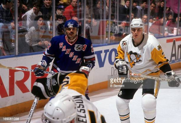 Mike Gartner of the New York Rangers and Grant Jennings of the Pittsburgh Penguins skate on the ice during their game on February 5 1992 at the...
